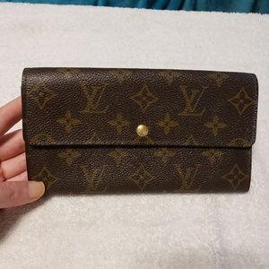 Louis Vuitton Sarah bifold long wallet.